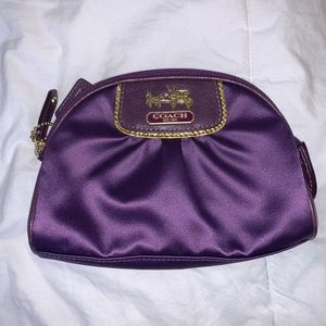 Purple Coach cosmetic pouch